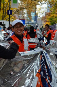A volunteer ready to hand out thermal blankets given to all runners