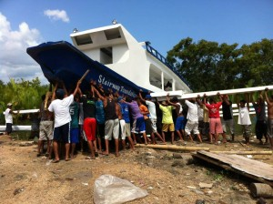 The whole community chips in to launch the boat!